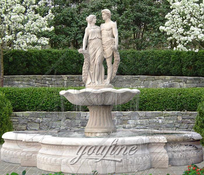 Outdoor natural marble water fountains with young lovers hold flowers for garden